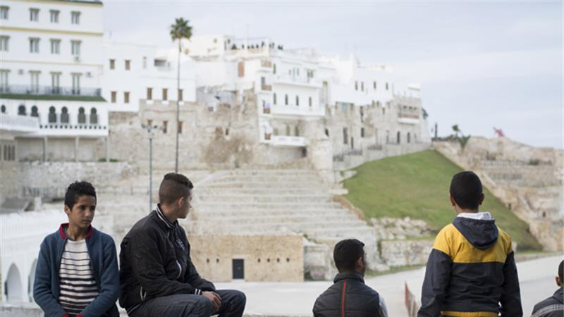 A group of minors, all aiming to cross to Spain, hang out by the port [Eloise Schieferdecker/Al Jazeera]