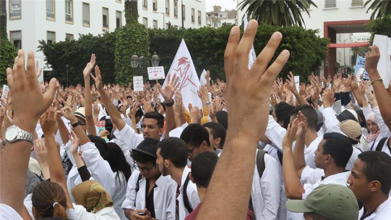 The proposed programme spurred protests, as hundreds of students clad in white lab coats took to the streets [Trey Strange/Al Jazeera]