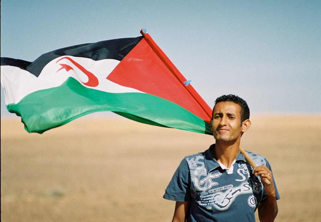 Sahrawi with flag. Credit: Creative Commons.