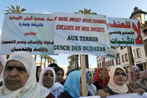Moroccan women attend a rally during International Women's Day in Rabat in 2011. The poster reads 'We are denied the rights to our land'. Women across tribal areas are seeking changes in laws that would allow them to inherit family land. ABDELHAK SENNAAFP/Getty Images
