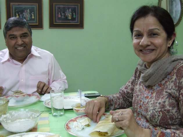 Rashmi and Kabir Sharma eating Dosas in their apartment just north of Delhi. | Photo by Mary Stucky