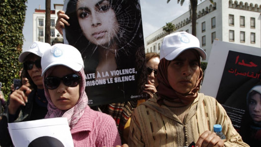 Activists from various women's rights associations gather while holding placards as they protest against the suicide of Amina al-Filali, 16, who was forced to marry the man who raped her, in Rabat. (Photo: REUTERS/Youssef Boudlal)
