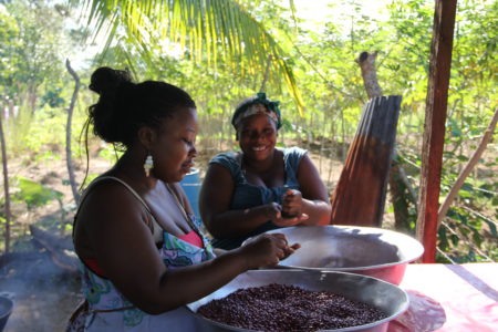 "Women prepare beans for a communal meal in Vallecito, Honduras. Teaser: ""…but in this remote region of the country, a piece of paper often means less than a big gun."""