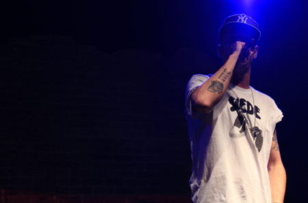 In Milan, Clementino at the opening concert of his first Italy-wide tour, with a flat-brimmed New York Yankees cap and tattoos down his arms. Photo: Zanna McKay