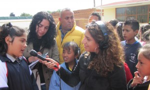 American journalist Monica Ortiz Uribe (in photo with mic) and Lillian Lopez Camberos, a Mexican journalist, interviewing in Mexico for this story.